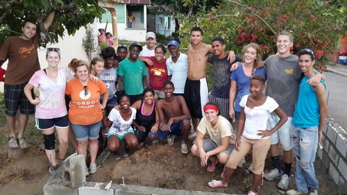 Group with Peace Corps volunteers and community members in front of the worksite, Photo by Ryan